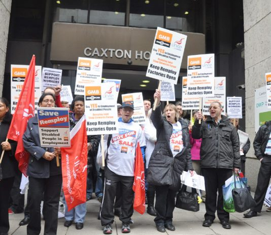 Remploy workers demonstrate outside the Department of Work and Pensions in central London yesterday demanding that their factories be kept open