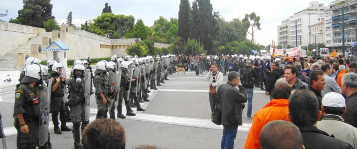 Riot police and demonstrations in front of the Vouli (Greek parliament)
