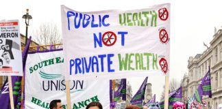 Health workers marching against Cameron's health policies on the TUC's March 26, 2011 mass demonstration