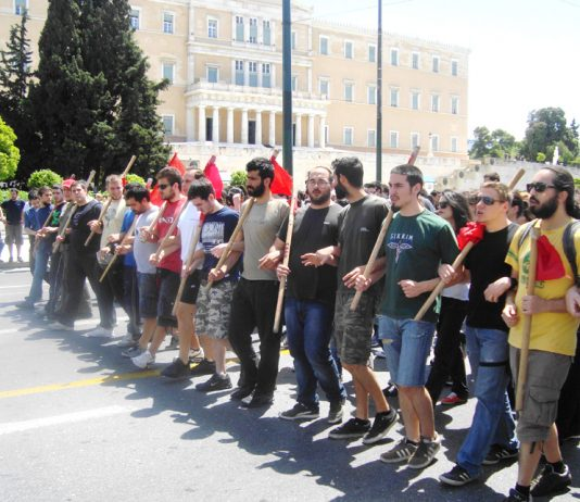 Athens university students marching past the Greek Parliament building on May Day – are calling for capitalism to be overthrown