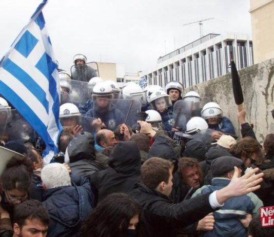Greek workers and youth confront riot police outside the Vouli in Athens
