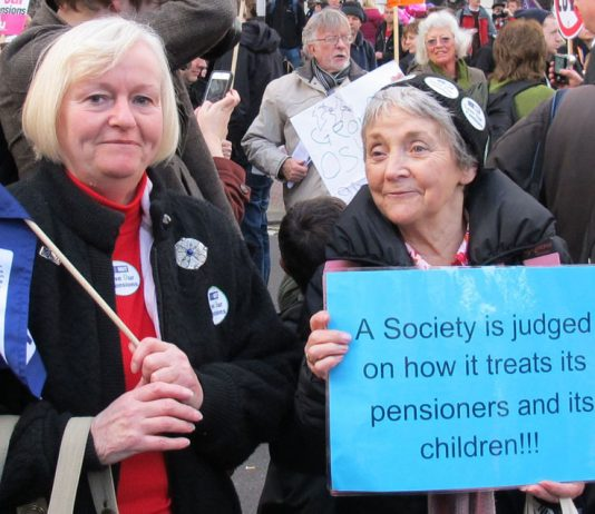 Marchers with a clear message on a demonstration during the pensions strike last November 30