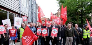 Unite strikers and their regional officers gather outside the King's Centre rally in Norwich