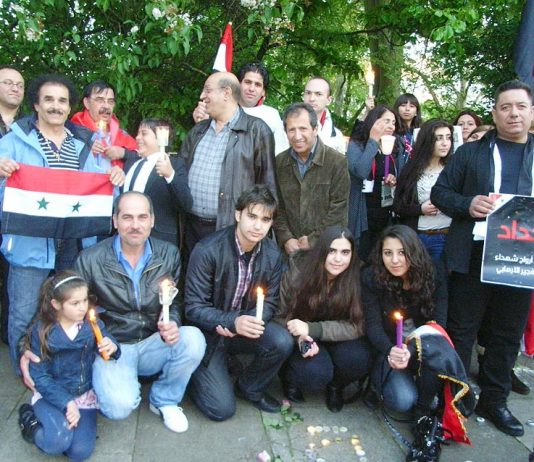 A section of the 100-strong vigil outside the Syrian embassy on Friday evening in memory of the over 70 killed in the latest bombing in Damascus