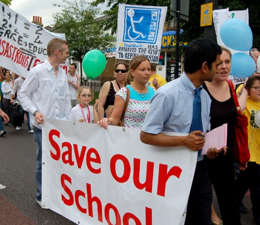 Special needs pupils and supporters march against the lack of places in state schools due to government cuts to resources