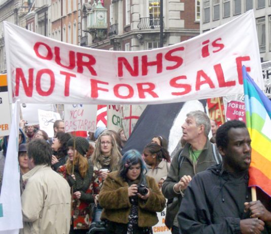 Hospital workers march against the coalition's NHS cuts