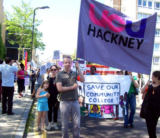 UCU lecturers facing 55 job cuts at Hackney College took to the streets with their banner along with students