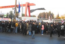 Illegally striking workers and their supporters outside the Hellenic Steel plant in Aspropyrgos near Athens