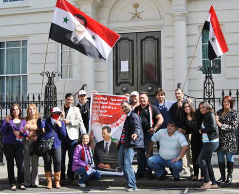 A section of the demonstration last Saturday outside the Saudi embassy in London accusing the Saudi regime of plotting with the Arab League and their imperialist allies to support terrorist attacks in Syria