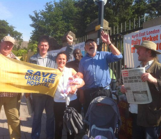Baby Zoe and mother outside Chase Farm Hospital on the 112th day of the picket of the hospital to keep it open in defence of the NHS. Everybody on the picket line supported the doctors' struggle to defend their pensions