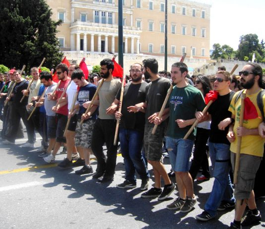 Greek youth marching to get rid of Greek capitalism, they want a socialist revolution