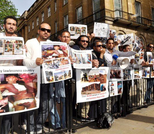 Libyans demonstrate outside Downing Street on Thursday against the NATO-imposed rebel regime in Libya