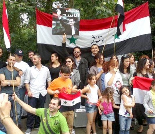 Syrians rally outside their embassy in London on Saturday to express their support for the Russian and Chinese use of their veto against the lastest US-UK resolution at the UN Security Council on Thursday