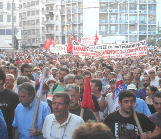 Greek workers on the march in Athens in support of striking steelworkers who have repeatedly been attacked by baton-wielding riot police