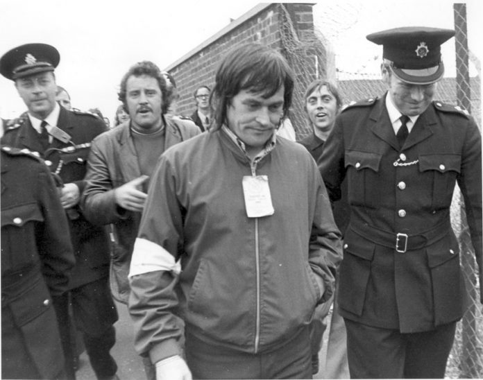 Police lead away Tony Merrick, one of the Pentonville 5, under arrest for picketing at the Midland Coal store in 1972. The dockers organised mass strike action and it took the threat of a general strike to gain their release