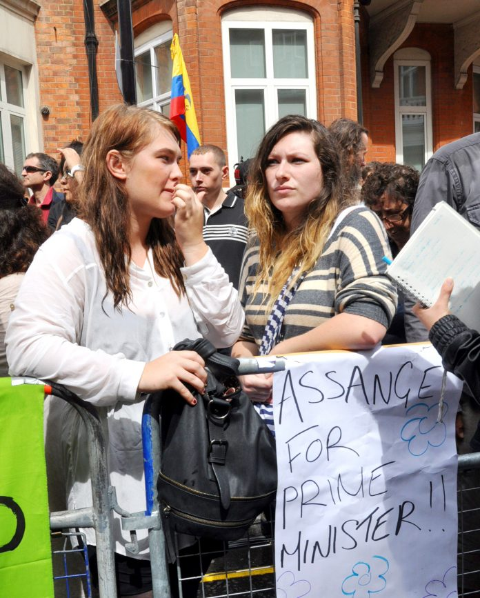 Two of the protesters outside the embassy of Ecuador who have ideas about making big changes in the UK