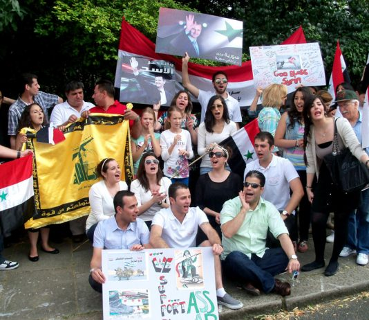 Syrian Youth in Britain demonstration outside their embassy in London on August 4th in support of President Assad and in  opposition to the US/UK-backed terror campaign in Syria