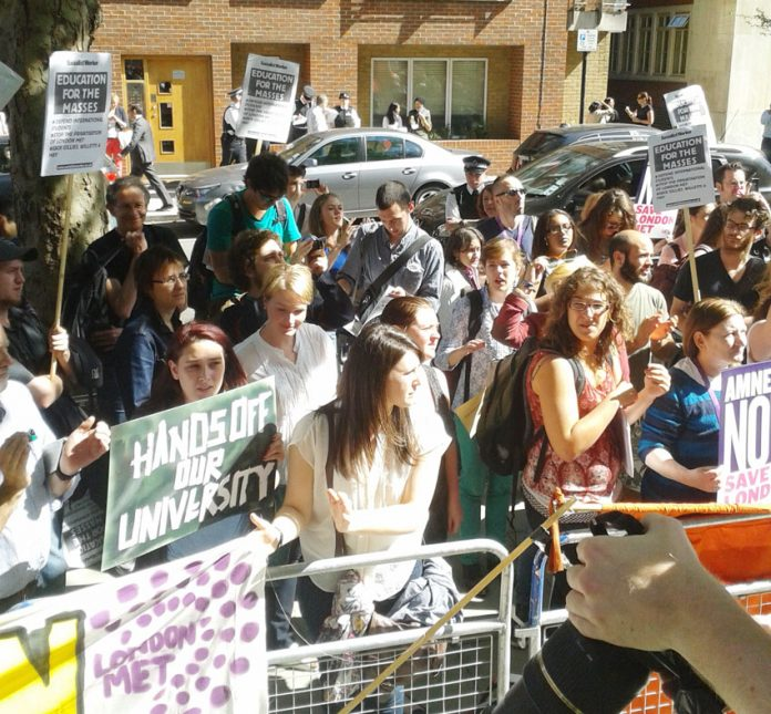 Sudents demonstrate outside the Home Office yesterday afternoon. They denounced the planned deportations