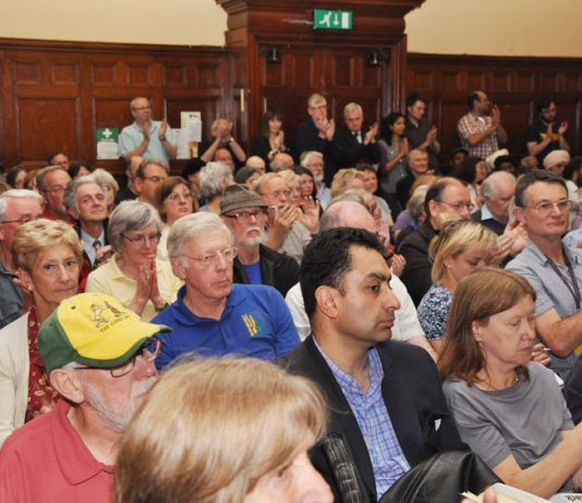 A section of a mass meeting in Ealing on 26 June to resist the closure of Southall's main hospital which the area cannot do without