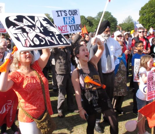 'Save Our Hospital' determined participants shout in Southall Park