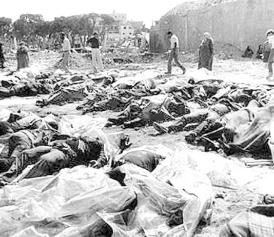 Piles of bodies of those killed by the Lebanese Christian Phalange militia under the direction of the