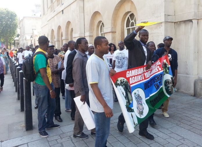 Gambians March on Downing Street - Gambian President Jammeh has called a temporary halt to executions they want it to be made permanent