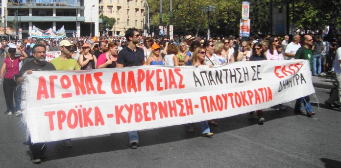 During the last Wednesday 's General Strike the Deimitra factory banner read 'Permanent struggle - our answer to  the troika, government, and plutocracy'