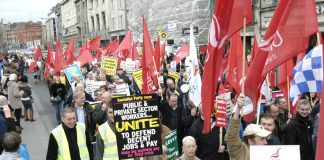 Workers marching in Dublin in defence of jobs