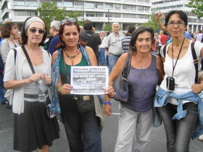 The Secretary of the Greek Cinema and TV Technicians trades union Chrysa Daponte and her friends at the Syntagma rally. Daponte is showing the newspaper of the Revolutionary Marxist League, Greek Section of the ICFI, with the headline 'for an indefinite p
