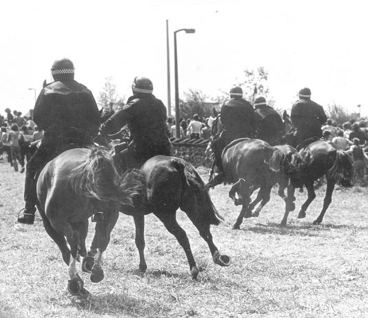Police on horseback charge at miners at Orgreave on 18th June 1984