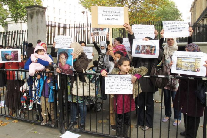 Women and children demonstrating outside Downing Street in London, England condemned the slaughter going on in Bani Walid