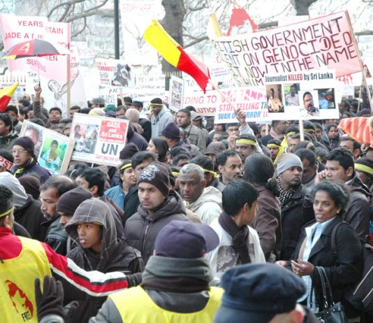 Marchers in London on January 31 2009 condemn the silence of the British government in response to the massacre of Tamils by the Sri Lankan army