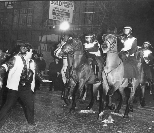 Mounted police charge striking Fleet Street printers at Wapping in the 1986-7 strike. The alliance of Murdoch, government and state against workers is now exposed