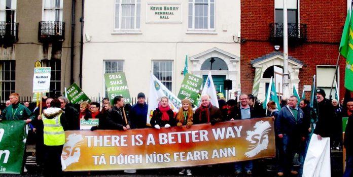 Sinn Fein banner on last Saturday's 20,000 strong march in Dublin. So far, 360,000 jobs have been cut in Ireland