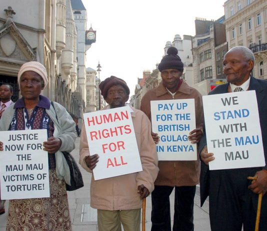 Kenyans who were tortured by British troops, outside the High Court in London