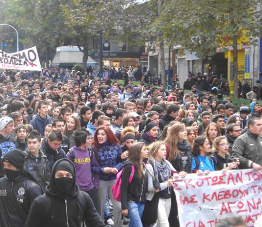 School students marching in Athens the banner reads 'They have killed Alexis, they are stealing our life – struggle for their overthrow!'