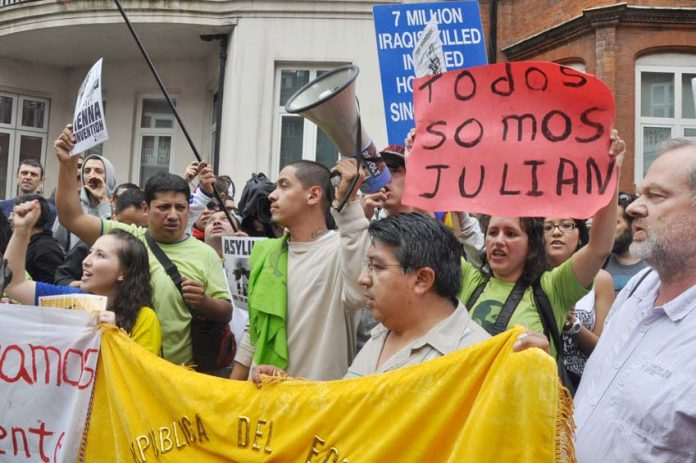 'We are all Julian' shout demonstrators outside the Ecuadorian embassy in London on August 18 when President Corea granted Assange political asylum to avoid extradition to the US