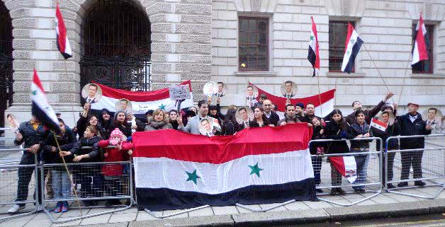 Syrians demonstrate outside the Foreign Office in London to show their support for President Assad against the British government's support for the opposition