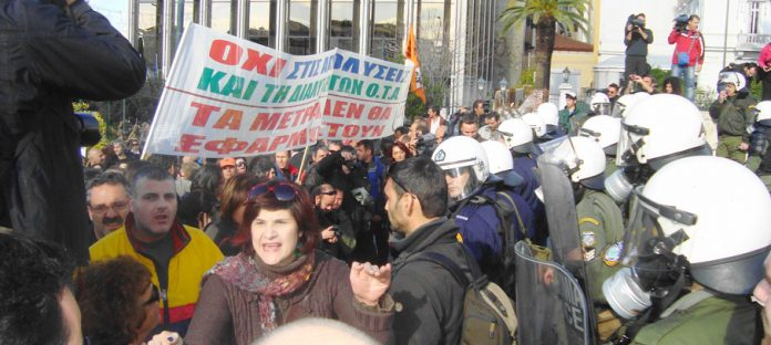 Marchers pushed aside the fence around the Greek parliament and chanted 'Bread, Education and Freedom'