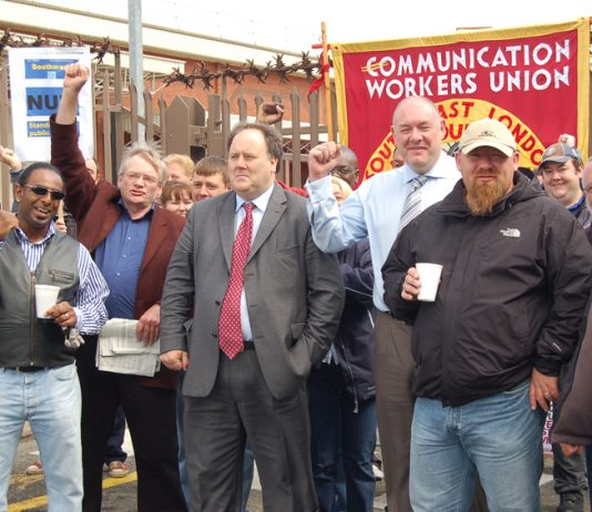 CWU leaders BILLY HAYES and DAVE WARD (centre figures) on the picket line at Mandela Way in south east London during the last national strike action in 2009