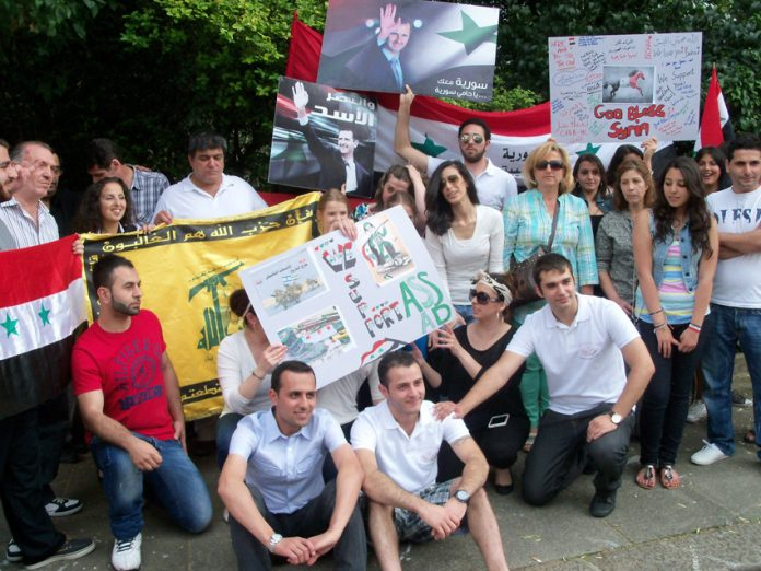 Syrian youth outside their embassy in London last August showing their support for president Assad