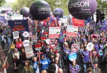 Unison members demand 'No NHS cuts or privatisation' on the TUC 500,000-strong demonstration in London last October