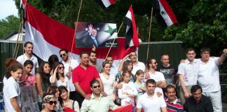 Youth and workers rally in support of Assad in central London outside the Syrian embassy