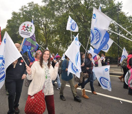 Midwives marching with their flags on last October's 500,000-strong TUC demonstration against the Coalition's austerity cuts