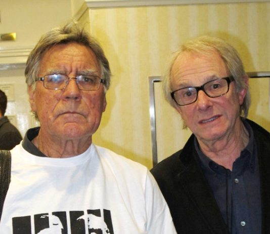 MIKE ABBOTT with KEN LOACH holding up a copy of 'The Key to My Cell' by Des Warren, the story of the building  workers' strike and the way in which it was attacked by the  capitalist state