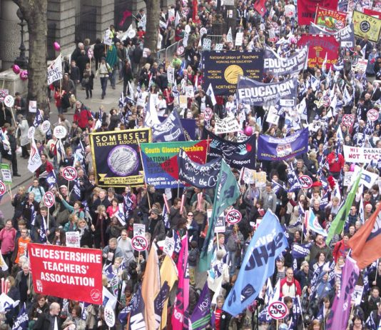 NUT banners on the march. The NUT regards league tables as a distraction from the hard work teachers do