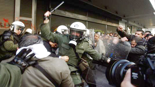 Greek riot police attack trade unionists with tear gas and truncheons outside the Labour Ministry