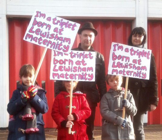 SARAH and BEN NORRIS with their triplets EVE, LOLA and DYLAN took part In the march to defend Lewisham Hospital on November 26