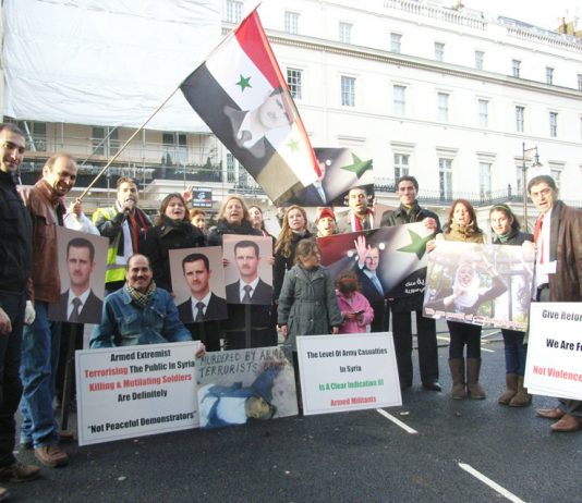 Syrians demonstrate outside the Syrian embassy in London in support of President Assad and against the armed gangs
