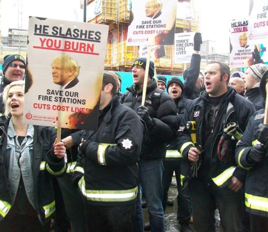 Firefighters demanding no cuts to the service outside yesterday's meeting of the Fire Authority